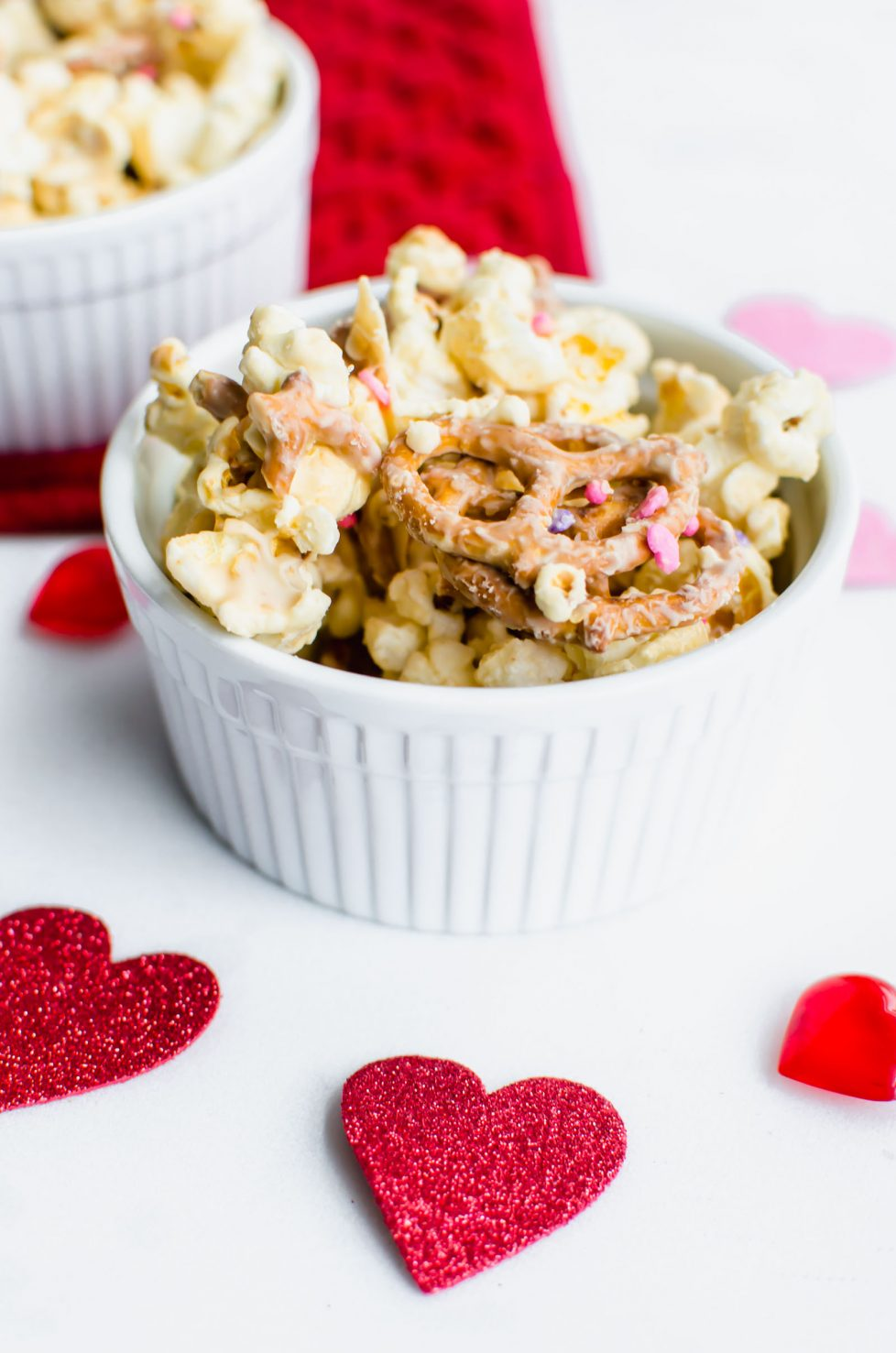 This recipe for Cupid Crack is a fun candied popcorn + pretzel snack mix that is a perfect treat to make for your Valentine! It's great to stuff in treat bags or to add to a festive gift basket.