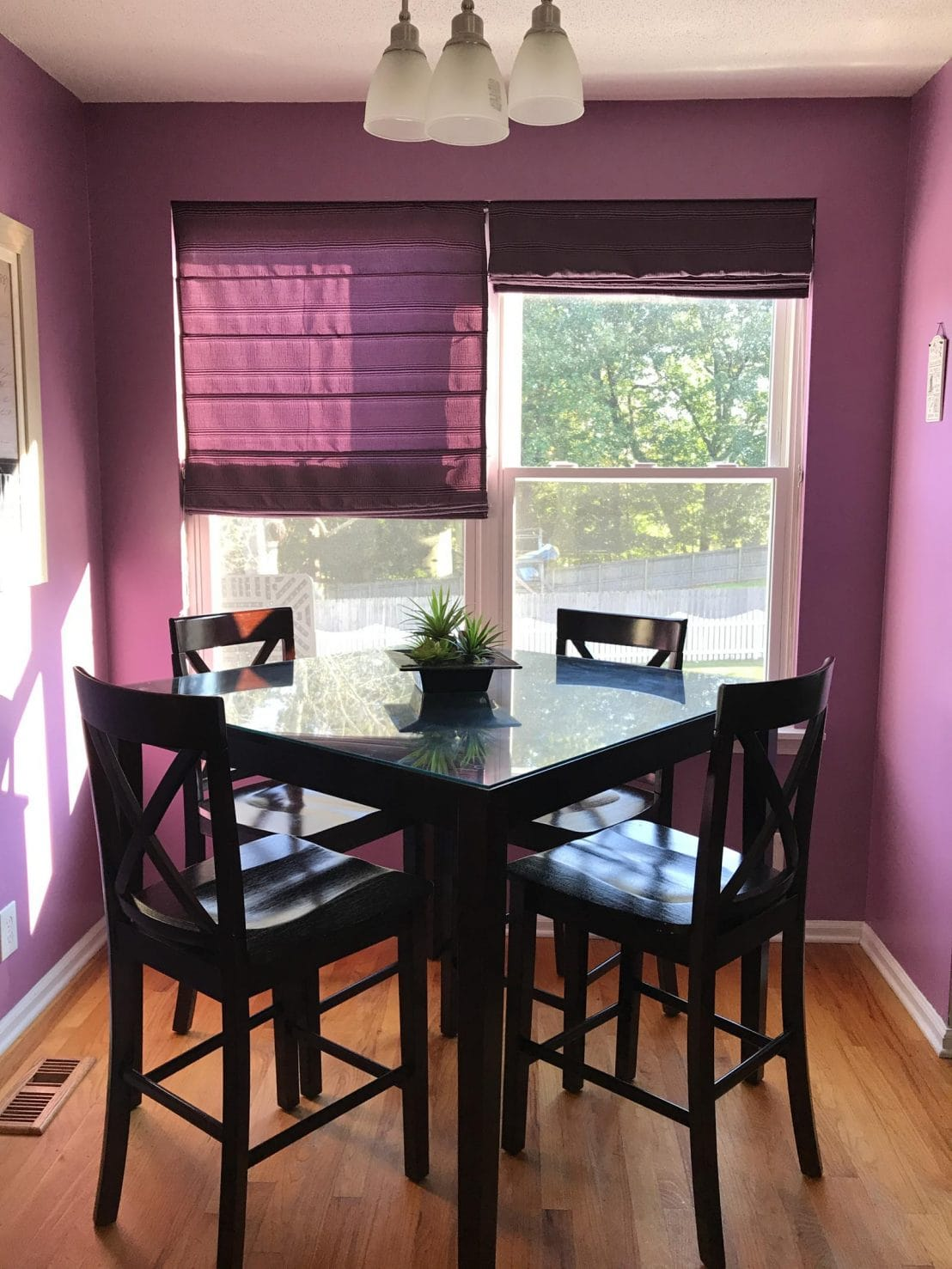 Our mini kitchen makeover featured a redo of the breakfast space. We added new paint and replaced the table with a French marble top island for prep and food photography. #homedecor #interiordesign #kitchenmakeover