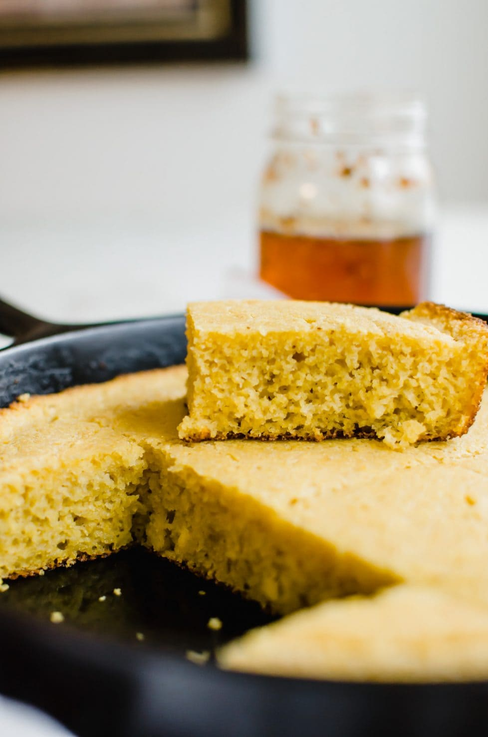 This recipe for whole grain buttermilk cornbread is a bread staple that I make over and over again! It's moist, easy to make, and super satisfying! #cornbread #southernfood