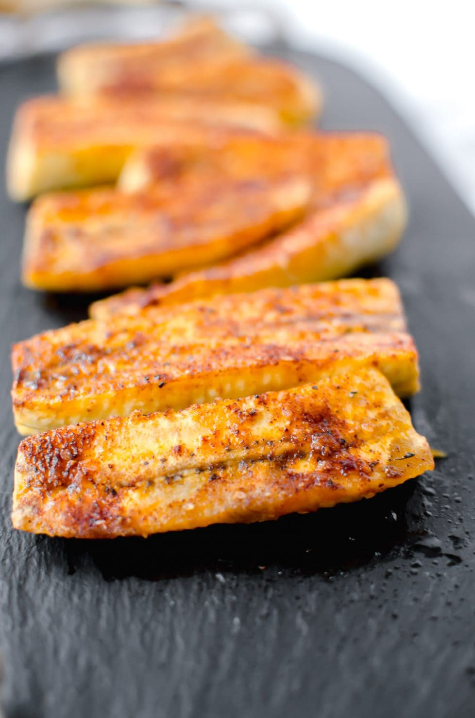 This recipe for sweet and smoky roasted plantains is such a fun, easy side dish to serve with any Mexican-style meal. The plantains are roasted and topped with a sweet and smokey rub.