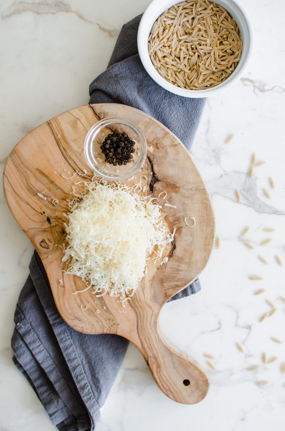 This simple recipe for Orzo Cacio e Pepe is a great option for a side dish on a weeknight to serve with grilled or roasted meats, fish, or a simple side salad! Easy Italian food that is healthy and tastes delicious!