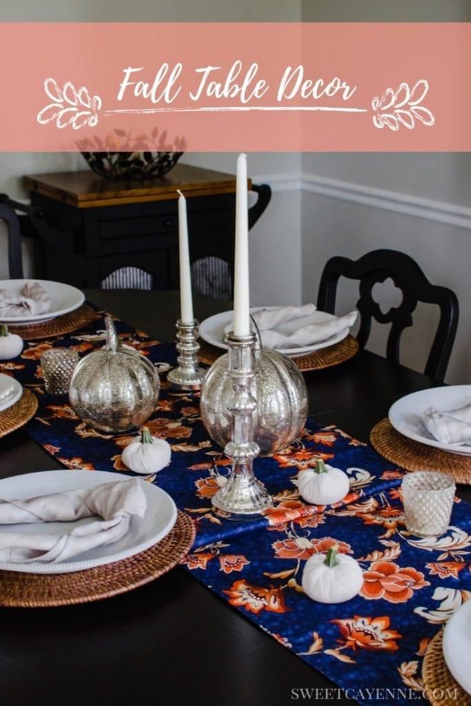 A fall decor tables cape with mercury glass pumpkins, candlesticks, and velvet pumpkins.