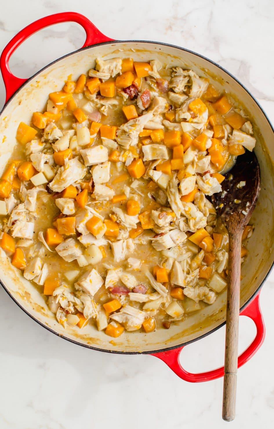 A pot with turkey pot pie filling.