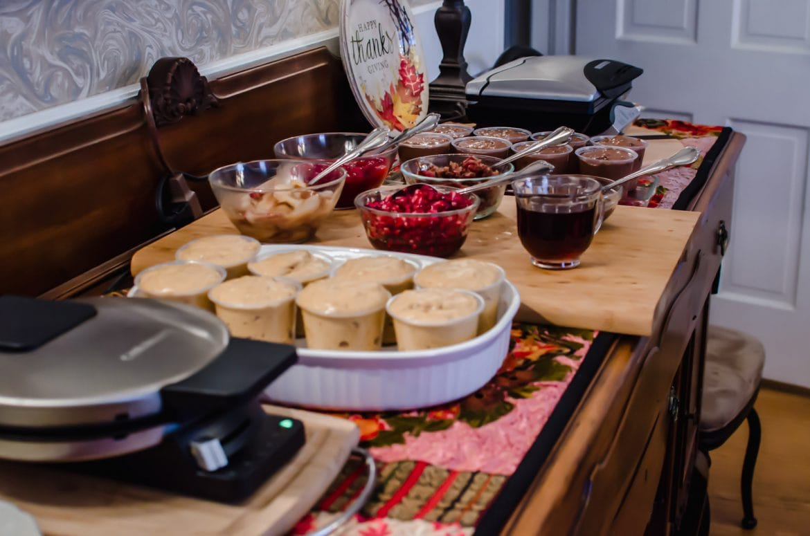 A make-your-own holiday waffle buffet set up in a dining room.