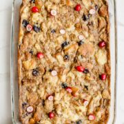 An overhead shot of a glass casserole dish with a baked bread pudding.
