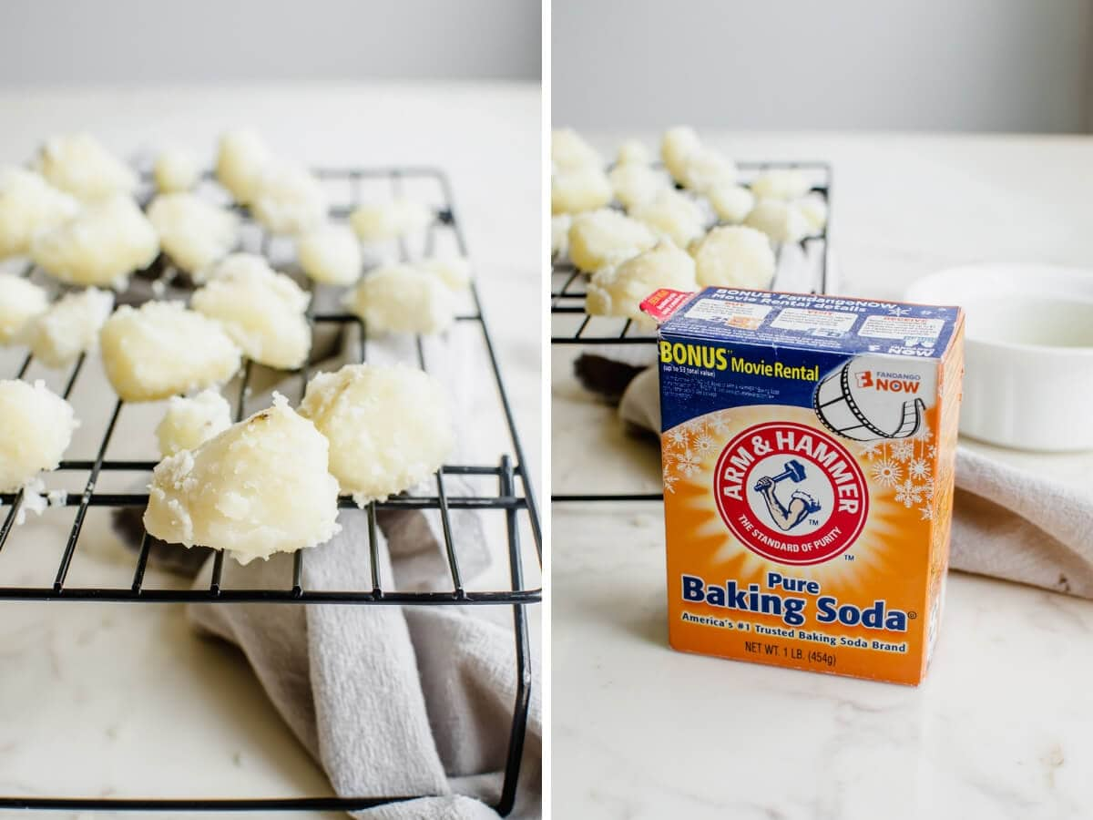 A wire rack with boiled potatoes cooling next to a box of baking soda.