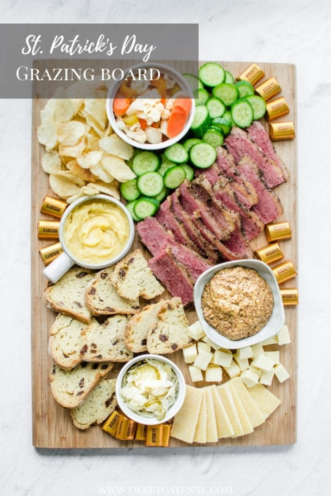 A wooden board filled with grazing platter foods for St. Patrick's Day.