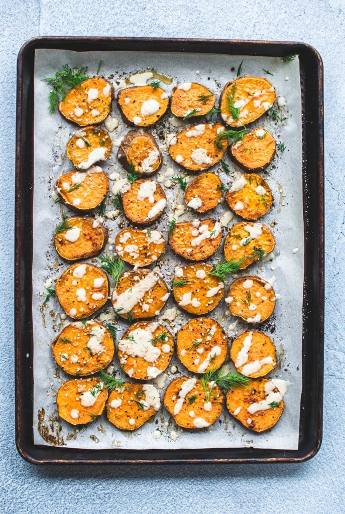 A sheet pan full of roasted sesame sweet potato rounds.