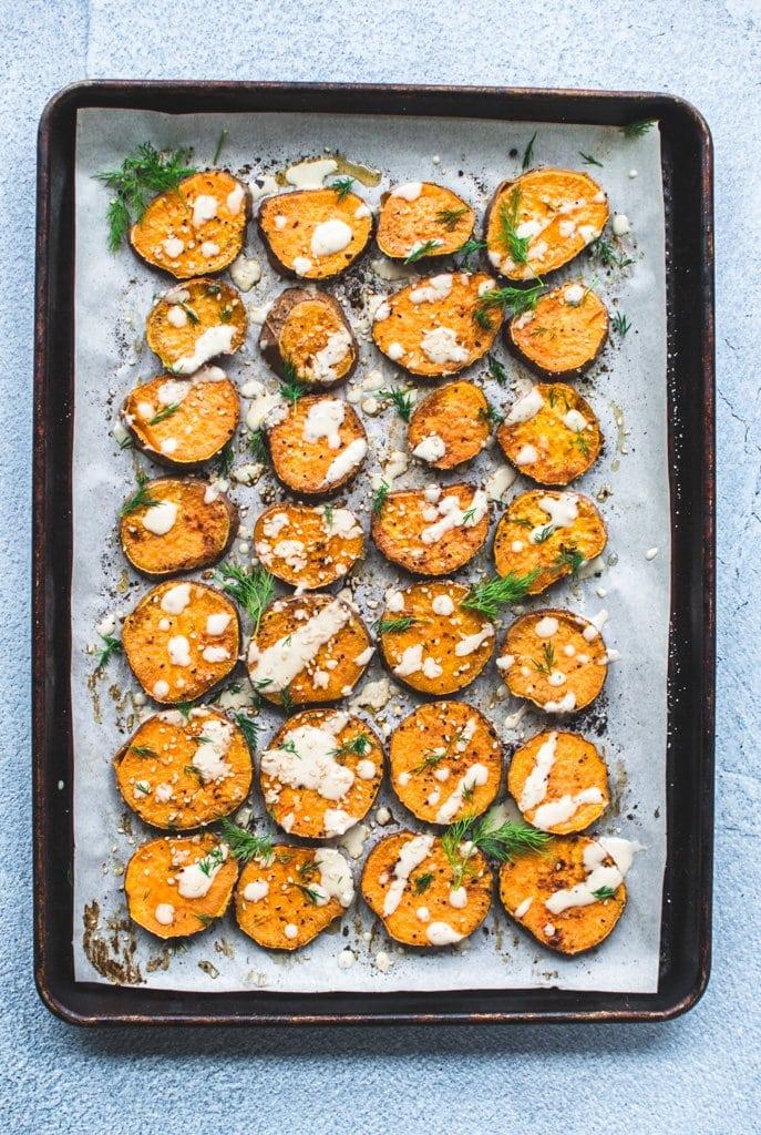 A sheet pan full of roasted sesame sweet potato rounds.