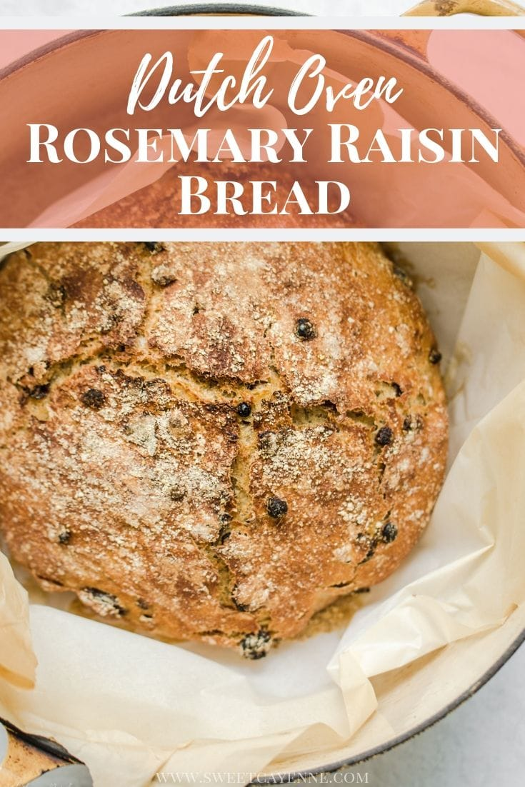 An overhead shot of a baked loaf of Rosemary Raisin Bread in a Dutch oven lined with parchment paper with text overlay for Pinterest.