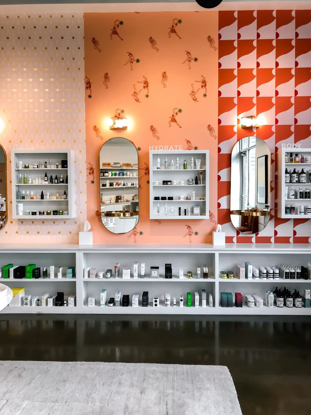 The product wall of skincare items at Lemon Laine Oil Bar in Nashville, TN.