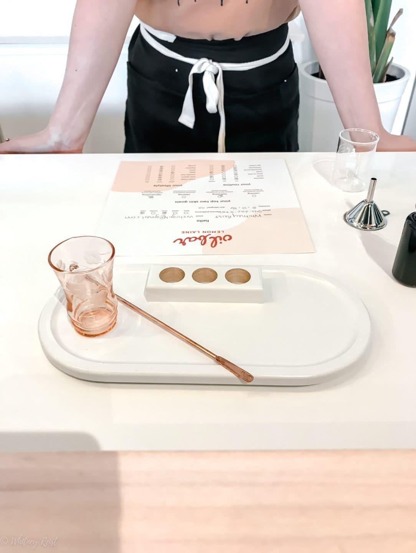 A skincare expert preparing to make a custom facial oil at Lemon Laine Oil Bar.