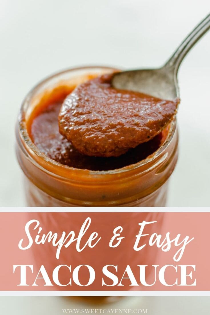 A jar of homemade taco sauce with a spoon lifting some out of the jar.