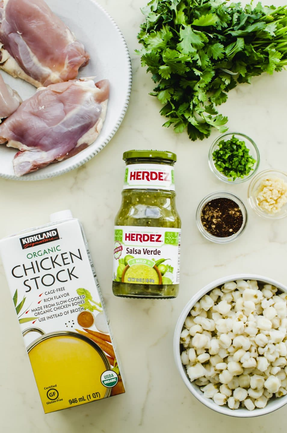 An overhead shot of the ingredients for Chicken Posole Verde.