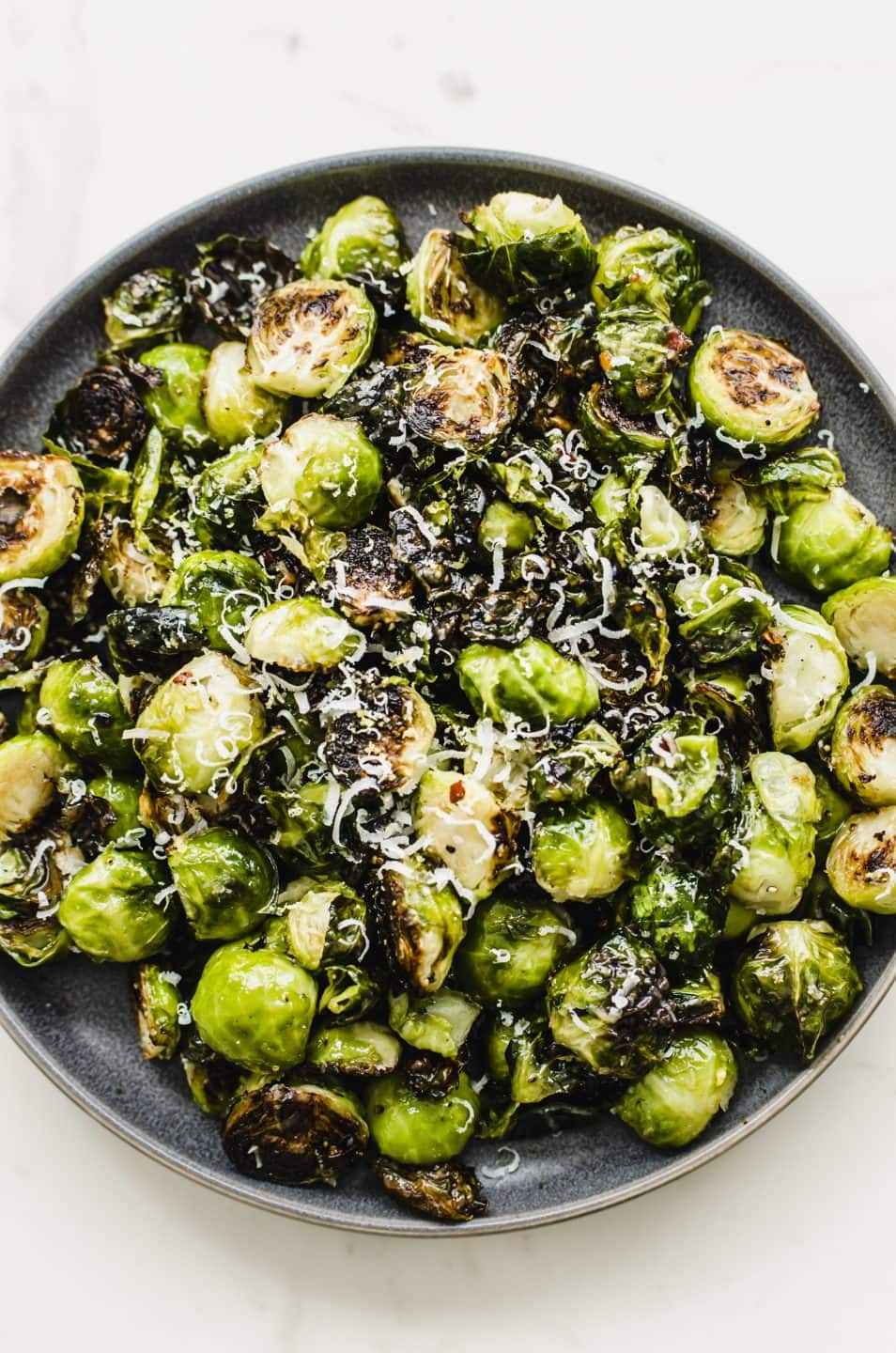 An overhead shot of a plate of crispy roasted Brussels sprouts.