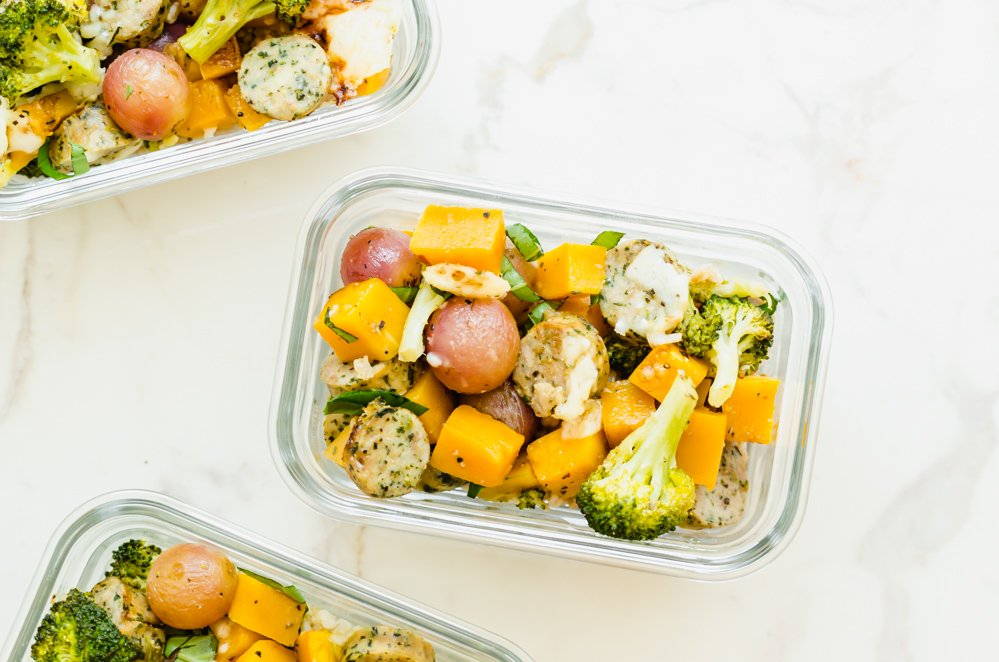 Glass meal prep containers filled with roasted veggies.