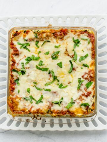 An overhead shot of a glass baking dish filled with baked Turkey Florentine Lasagna.