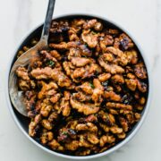 A Christmas cookie tin filled with Chipotle Rosemary Roasted Walnuts