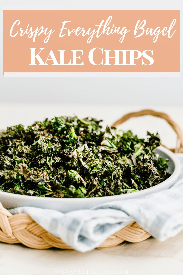 A side shot of a plate of kale chips on a gingham dish towel inside a rattan charger.