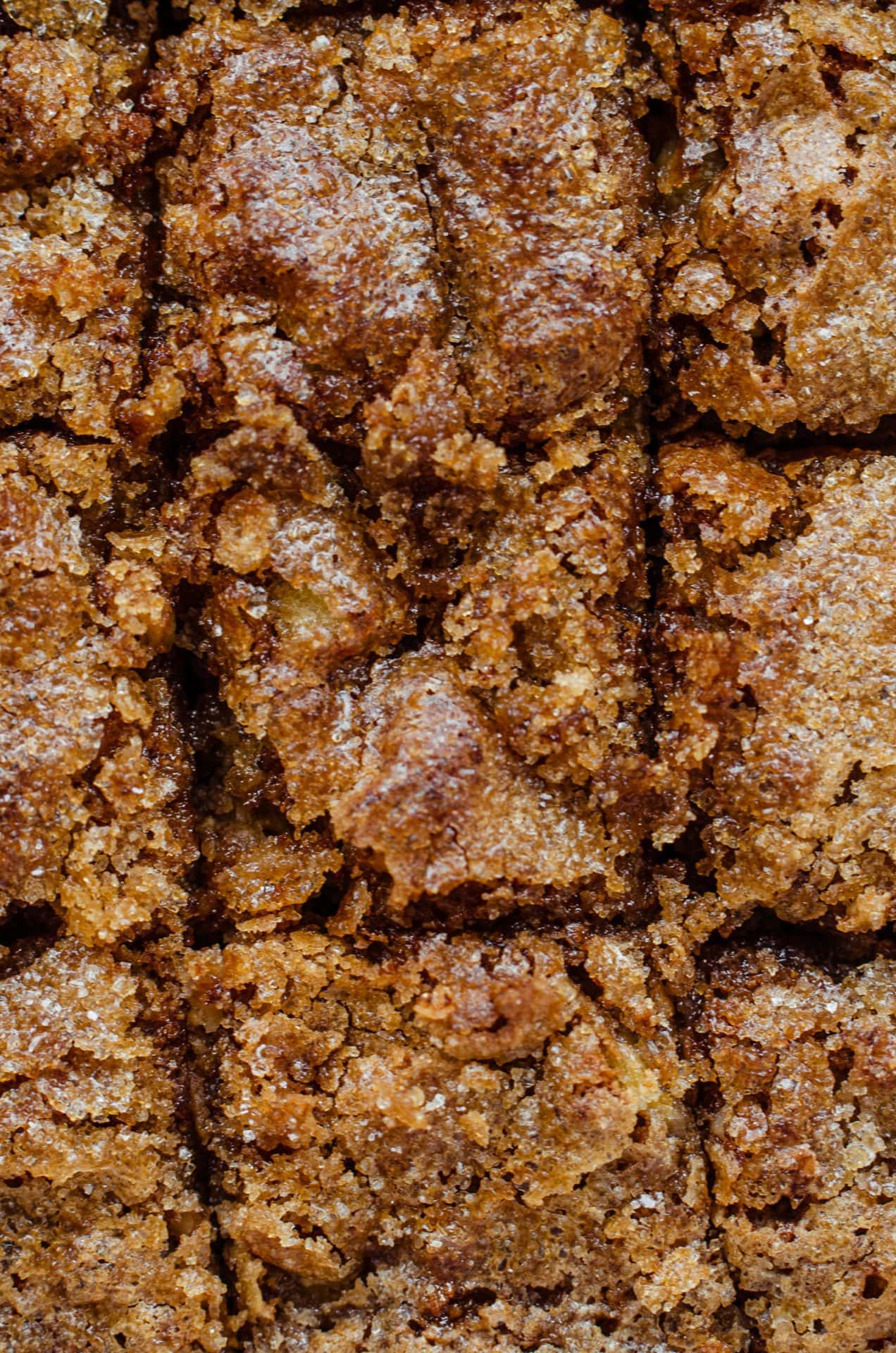 An up-close shot of the crunchy sugar topping on baked banana bread.