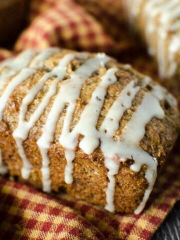 Side view of mini banana bread topped with drizzle icing.