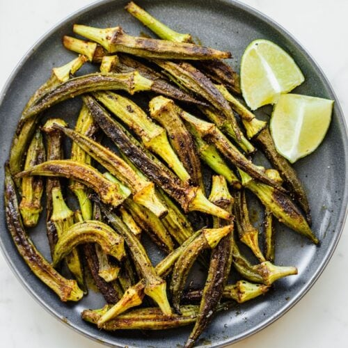 Blue plate covered with roasted okra.