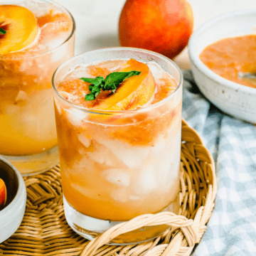 A short glass tumbler filled with peach lemonade.